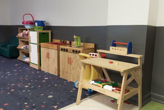 PTLL interior, play tools, play kitchen, shelf holding baby dolls