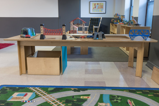 PTLL interior, wooden train table with bridges and tunnels