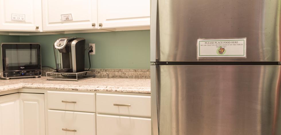 PTLL interior, kitchen, showing microwave, cabinets, coffee maker, fridge