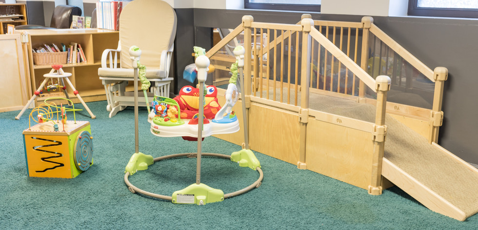 PTLL interior, infant area, showing wooden climber, activity jumper, rocking chair