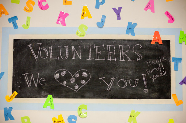 Chalkboard with Volunteers we heart you, Thanks for all you do written on it