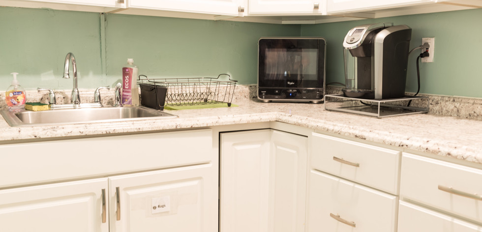 PTLL interior, kitchen, showing sink, microwave, coffee maker