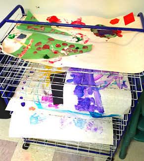 Shot of drying rack that holds children's paintings