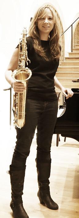 holding saxophone