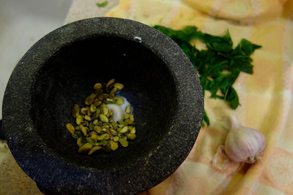 pistacios sea salt and garlic in the mortar bowl.JPG