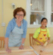 Mother and daughter pasta makers