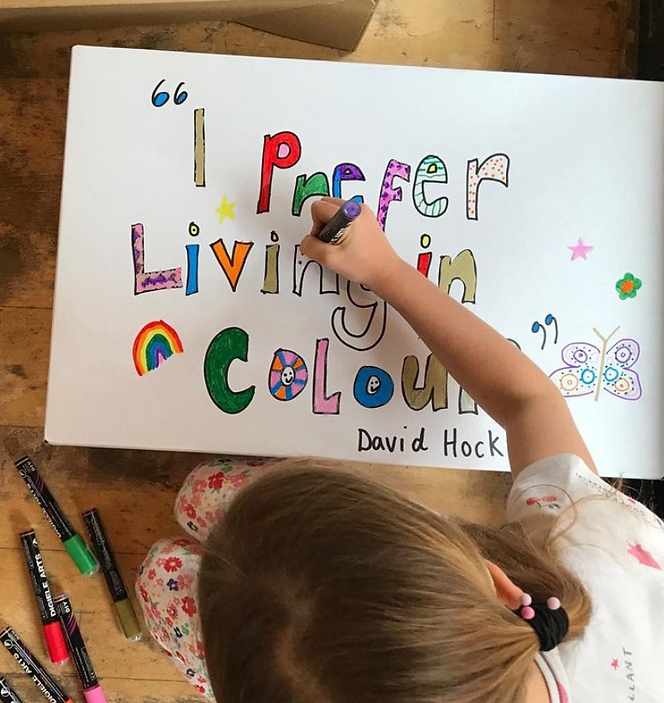 """A child colouring in a picture with marker. the picture says, """"I prefer living in colour"""""""