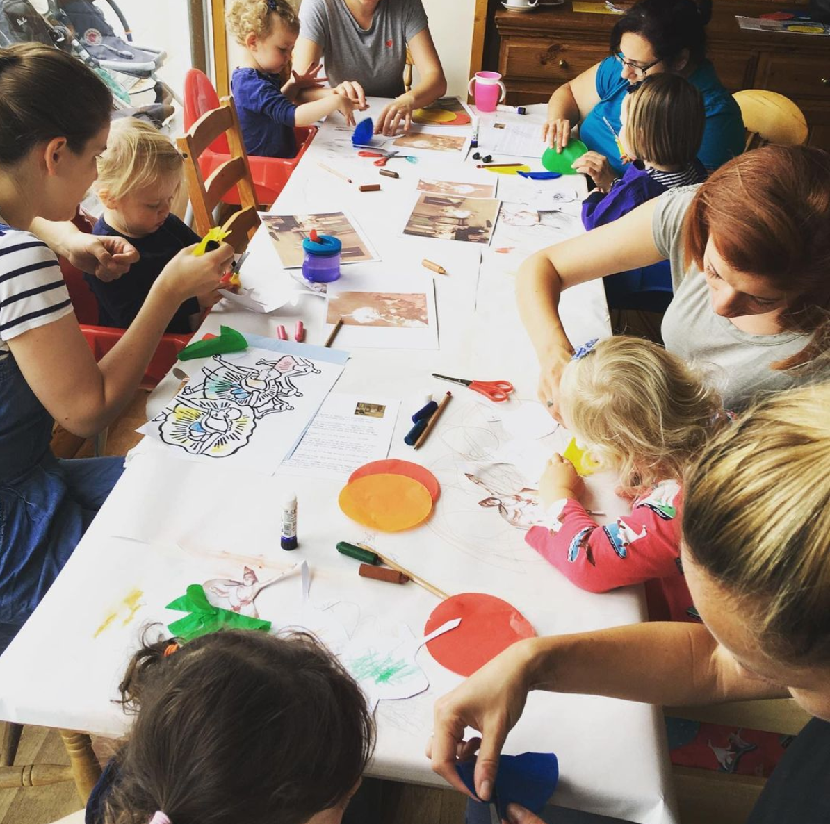 adults and children in art class