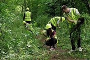 Nationwide Volunteers clearing a path in Eastfield Park Northampton
