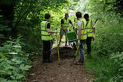 Nationwide Volunteers adding wood chippings to a path in Eastfield Park Northampton