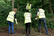 Nationwide Volunteers clearing area for planting in Eastfield Park Northampton
