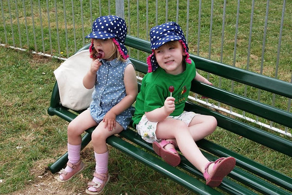 Young children on a park bench