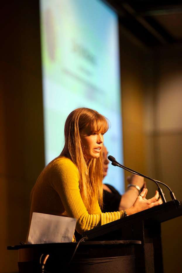 Lily speaking at conference.jpg