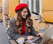 busy-smiling-female-freelancer-spending-