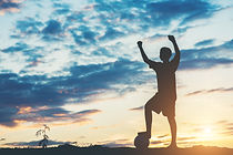 silhouette-of-children-play-soccer-footb