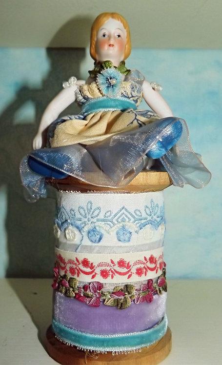 Doll on Spool