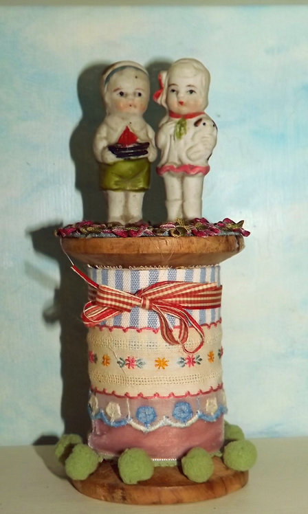 Little Boy & Girl on Spool