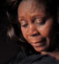 black lady grieving.jpeg
