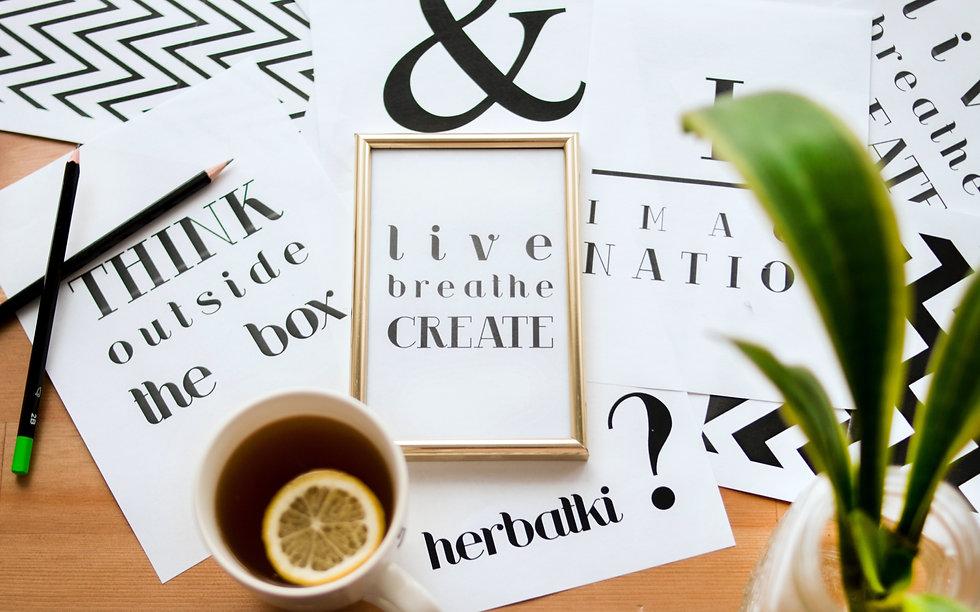 quote-calligraphy-under-cup-of-lemon-tea