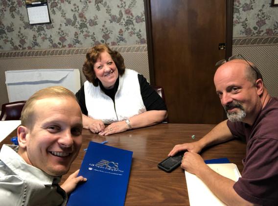 At the closing table acquiring a new mobile home park