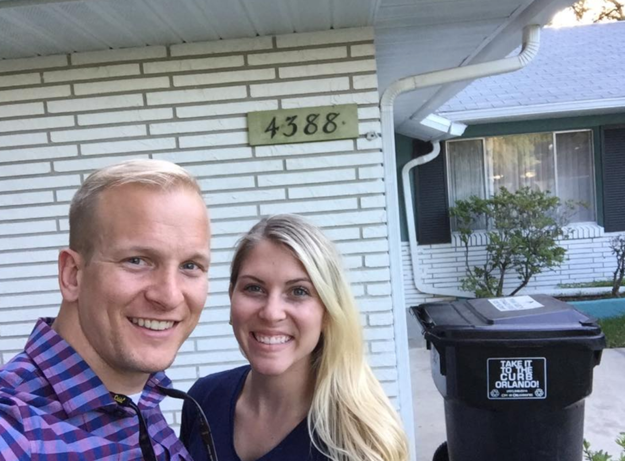 Andrew with Katie at the first rental property they purchased in 2015
