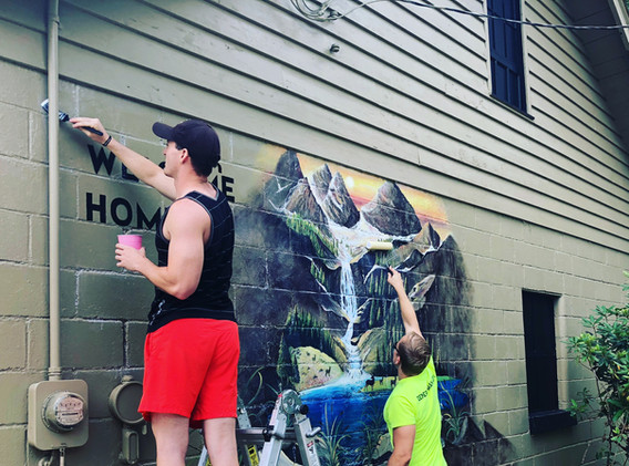 Rebranding and painting a mural at the entrance of Deer Run