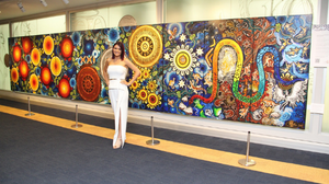 Chern'ee Sutton with her Painting