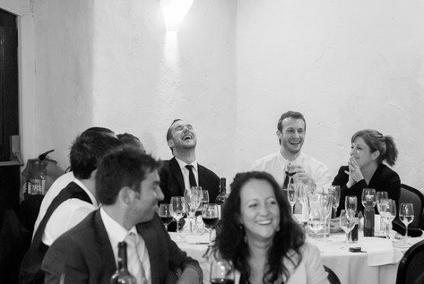 Guests laughing during reception speeches at Priston Mill, Bristol