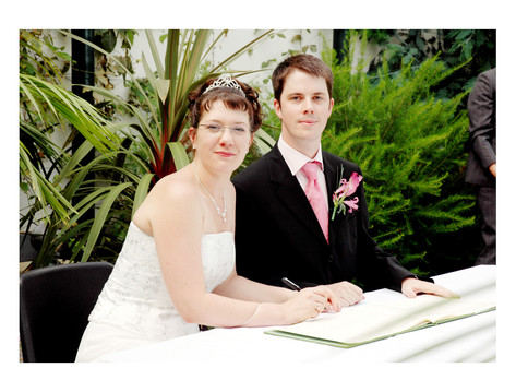 Bride and Groom sign the register at Sheffield Botanical Gardens