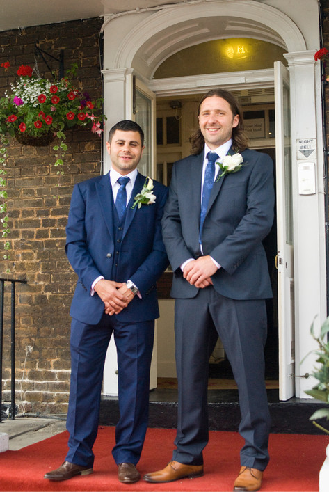 Groom & best man outside Hampton Court Mitre Hotel