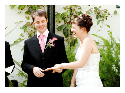 Bride & Groom exchanging rings during wedding ceremony at Sheffield Botanical Gardens