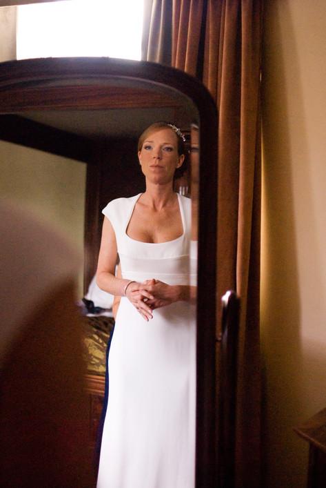 Bride in mirror at Hampton Court Mitre Hotel