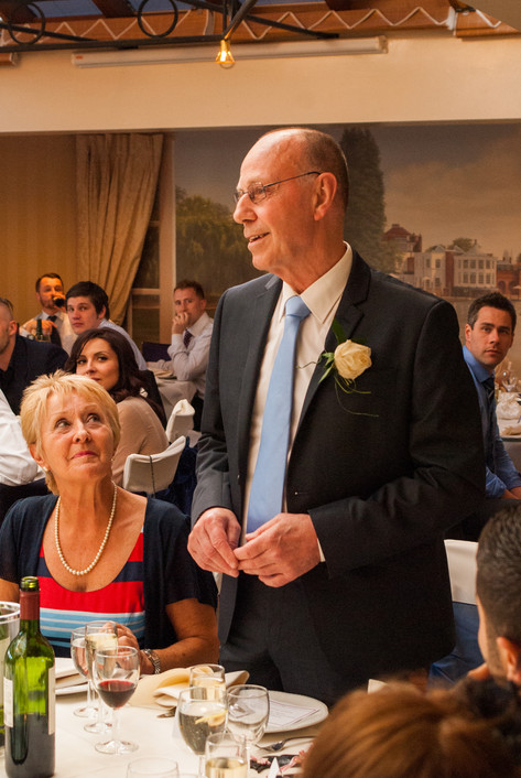 Father of the Bride and bride during wedding reception at Hampton Court Mitre Hotel