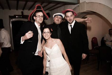Bride with guests and hats at Priston Mill, Bristol