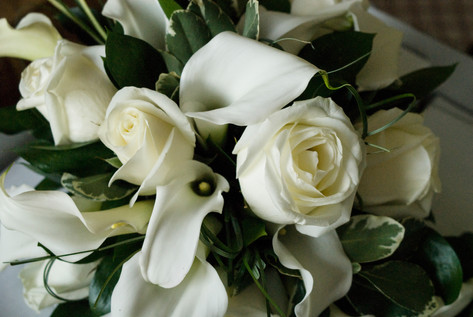 Bridal bouquet of white lillies and white roses