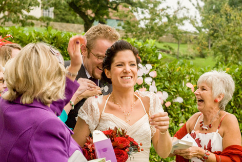 Bride & groom being showered with confetti at Priston Mill, Bristol