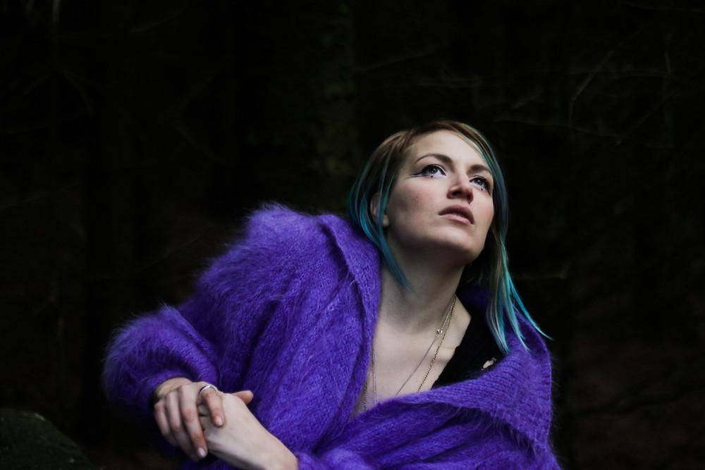 Breezy Lee, in purple cardigan