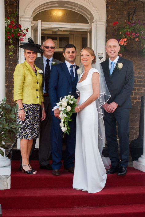 Group shot of Bride & Groom with parents at Hampton Court Mitre Hotel