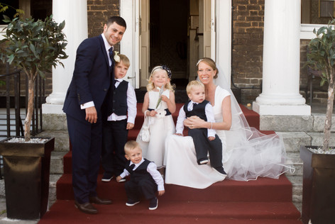 Group shot of Bride & Groom with bridesmaids and paige boys at Hampton Court Mitre Hotel