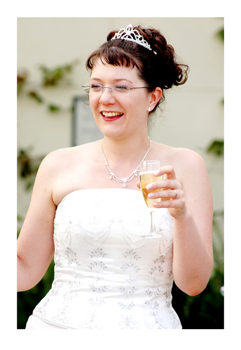 Bride with champagne at Sheffield Botanical Gardens