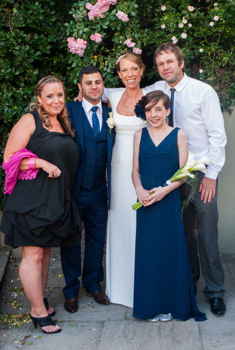 Bride & groom with guests during wedding reception at Hampton Court Mitre Hotel