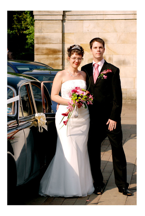 Bride and Groom in front of car at Sheffield Botanical Gardens