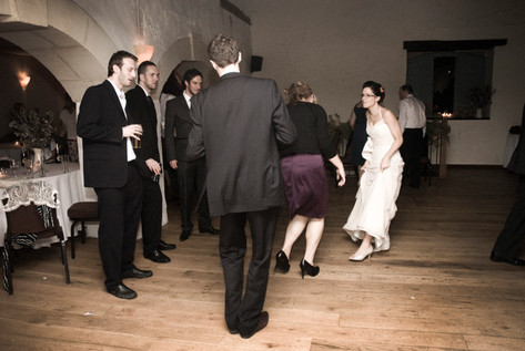 Bride and guests dancing at Priston Mill, Bristol