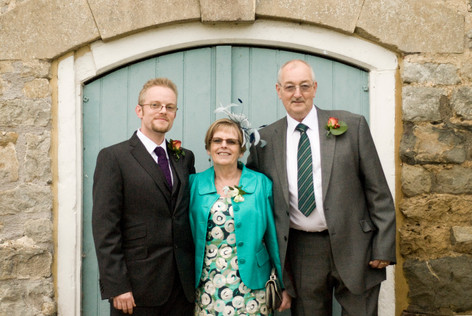 Groom with parents at Priston Mill, Bristol