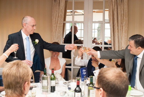 Father of the Bride and Father of the groom toast during wedding reception at Hampton Court Mitre Hotel