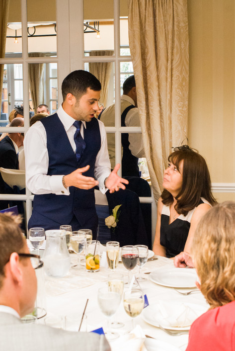 Groom and Mother of the Groom during wedding speeches at Hampton Court Mitre Hotel