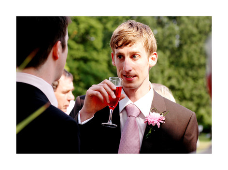 Wedding guests with drinks at Sheffield Botanical Gardens