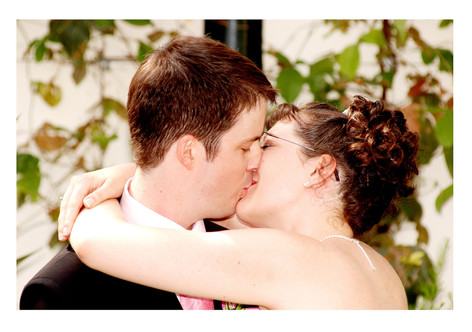 Bride & Groom kiss during wedding ceremony at Sheffield Botanical Gardens