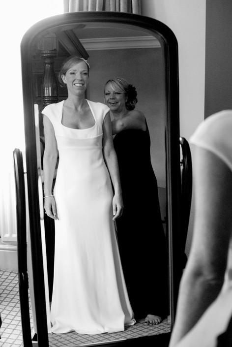 Bride & Bridesmaid in mirror at Hampton Court Mitre Hotel