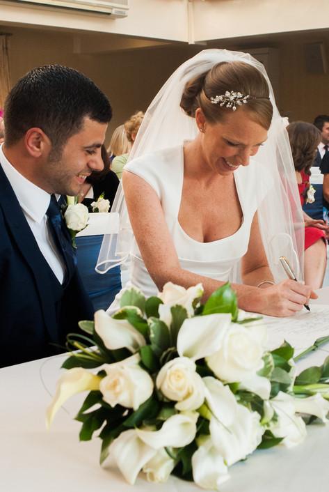 Bride & Groom signing the register at Hampton Court Mitre Hotel